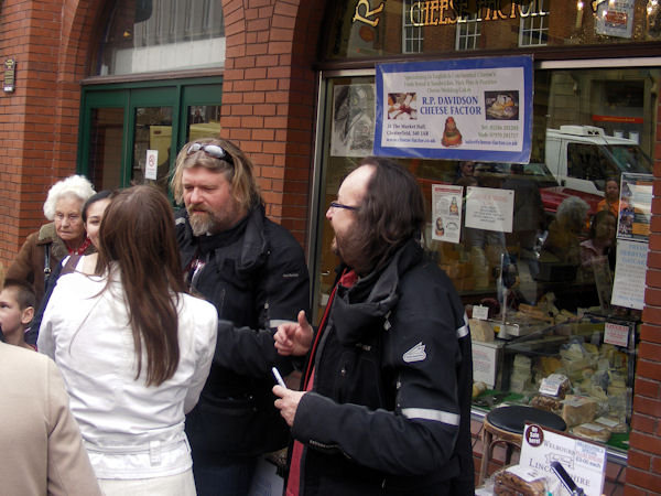 Si and Dave talk to Chesterfield Market visitors outside The Cheese Factor shop