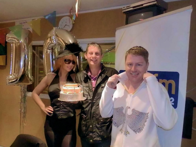 Presentation of celebration cheese cake to PeakFM for its 10th Birthday Celebration